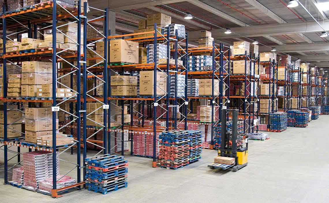 Pallet racking with barrier